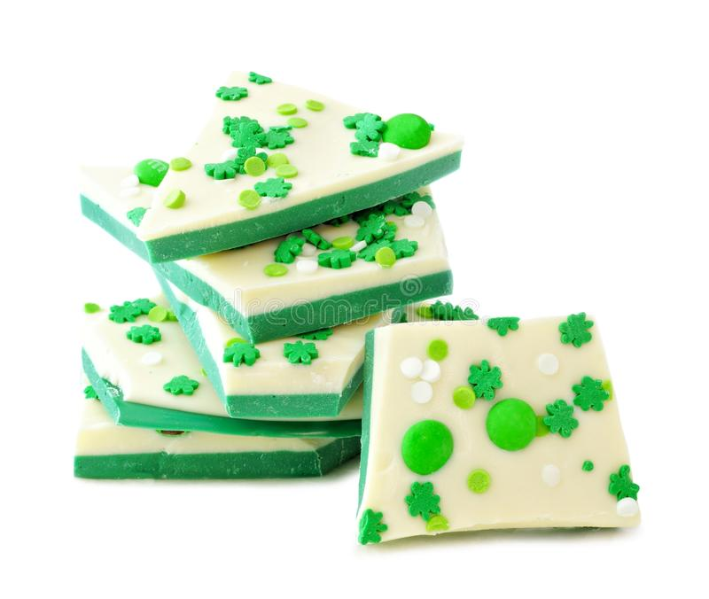 St Patricks Day chocolate candy bark, stacked over white. St Patricks Day chocolate candy bark with shamrock sprinkles, stacked over a white background royalty free stock images