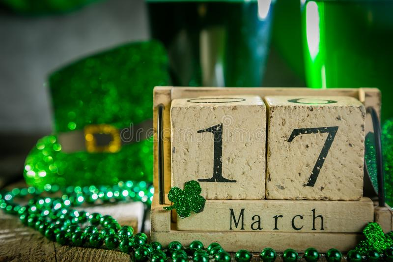 St. Patricks day concept - green beer and symbols royalty free stock photography