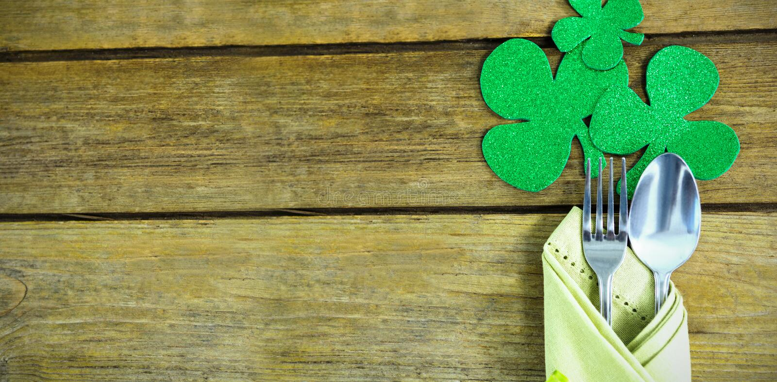 St Patricks Day fork and spoon wrapped in napkin with shamrocks royalty free stock images