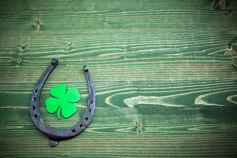 St. Patricks day, lucky charms on green wooden background. Top view royalty free stock image