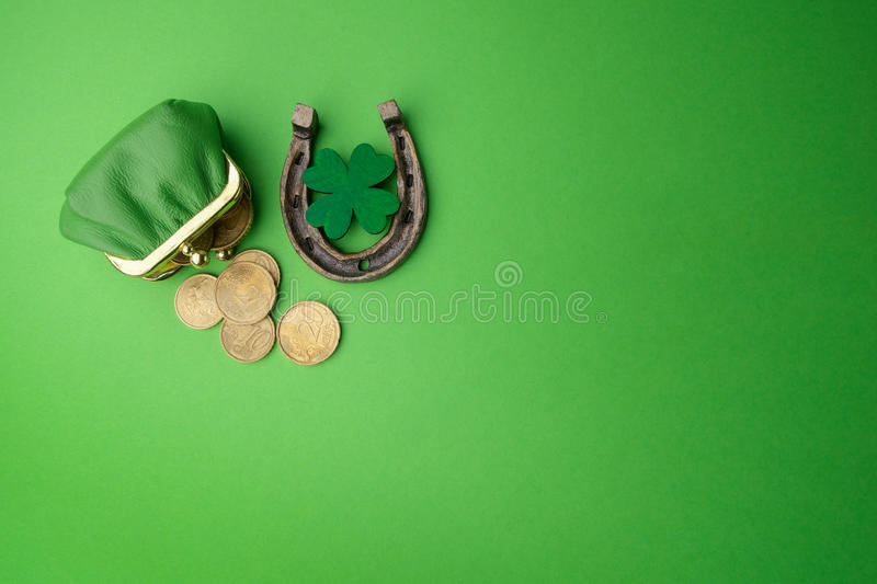 St. Patricks day, lucky charms. Horesechoe and shamrock on green background stock images