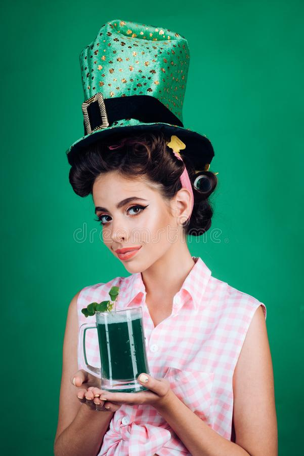 St. Patricks Day pinup girl with fashion hair. pretty girl in vintage style. pin up woman with trendy makeup. retro. Woman drink summer cocktail. Party girl royalty free stock image
