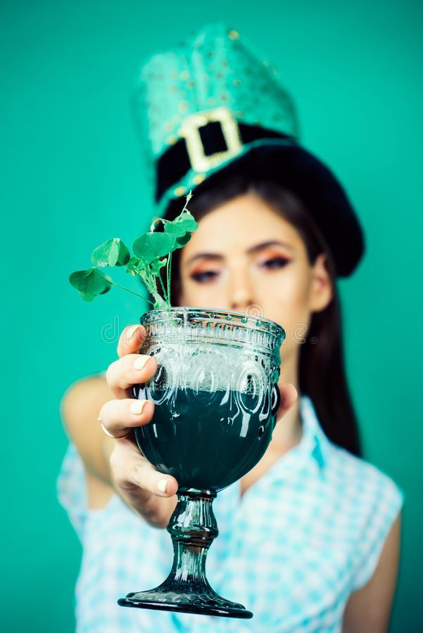St. Patricks Day pinup girl with fashion hair. pretty girl in vintage style. pin up woman with trendy makeup. retro. Woman drink summer cocktail. this is for royalty free stock images