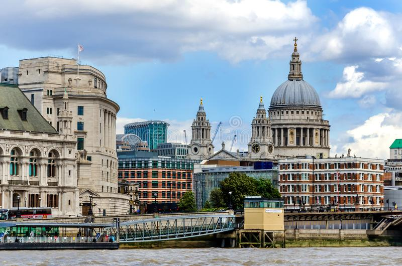 St. Paul Cathedral and city skyline across the River Thames royalty free stock images
