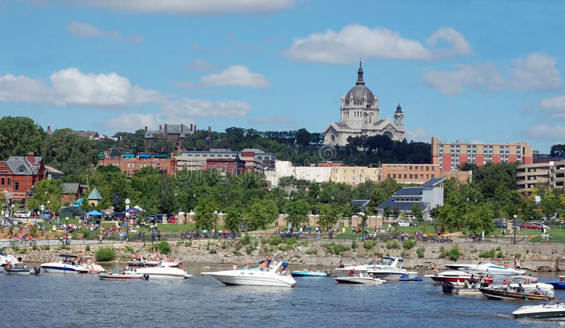 St. Paul Cathedral from Harriet Island. A View of St. Paul MN. From Harriet Island a popular event spot. Lots of activity on the river and the shores royalty free stock images