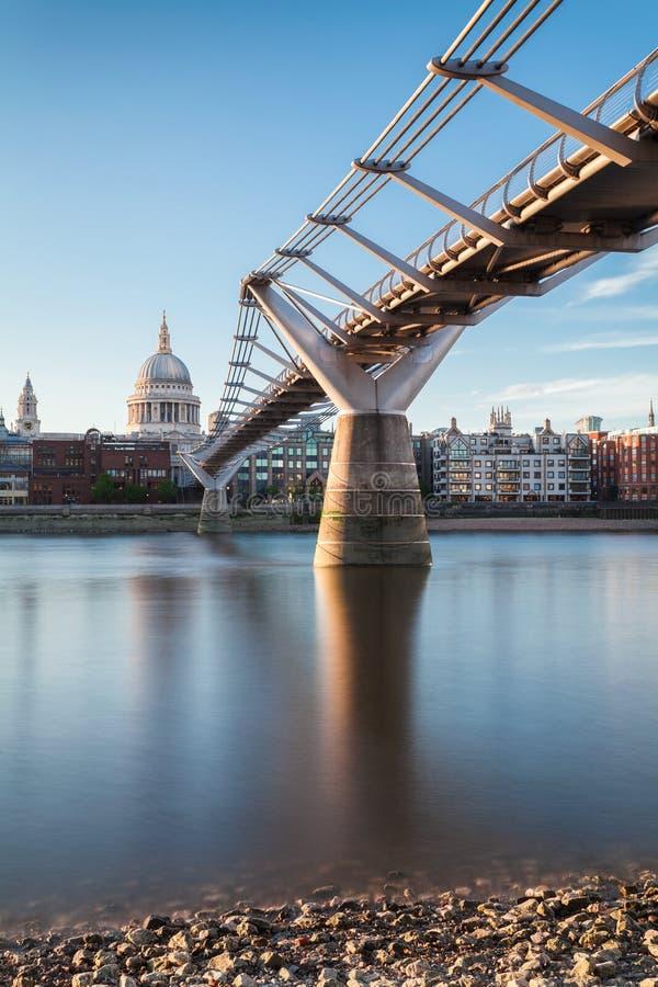 St. Paul cathedral and Millennium Bridge, London, UK royalty free stock image