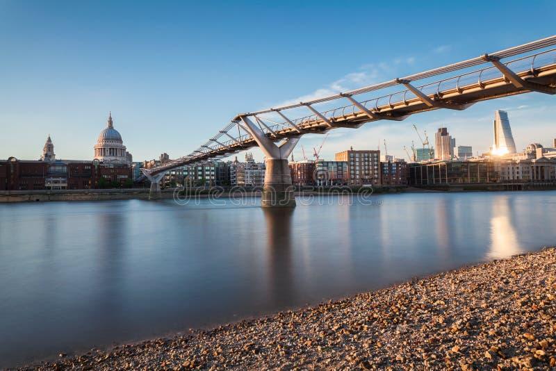 St. Paul cathedral and Millennium Bridge, London, UK royalty free stock photo