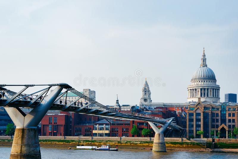 St Paul Cathedral and Millennium Bridge over Thames River London stock photo