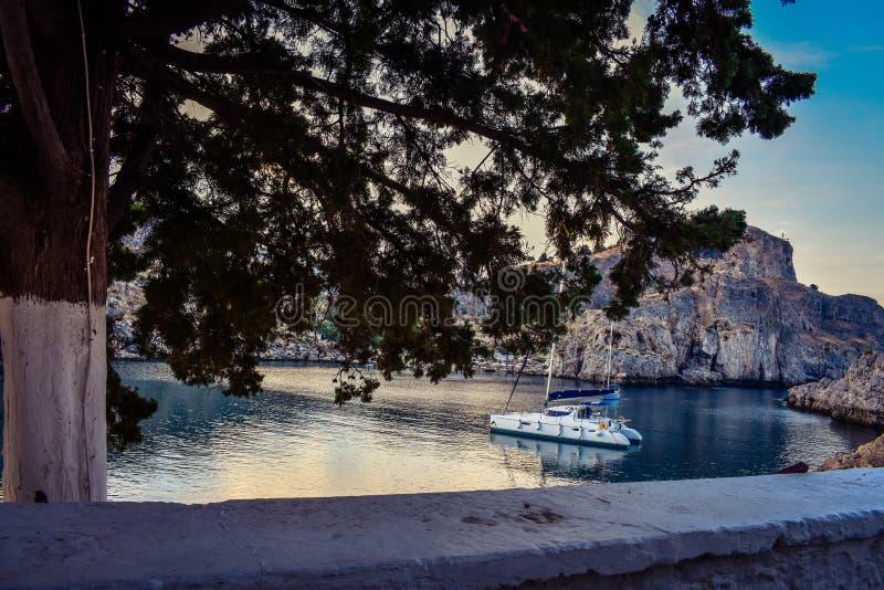 ST Paul`s bay,and horizon Aegean sea. LINDOS,RHODES/GREECE NOVEMBER 1 2018 : ST Paul`s bay,and horizon Aegean sea royalty free stock photo