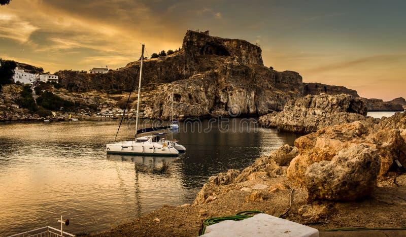 ST Paul`s bay,and horizon Aegean sea. LINDOS,RHODES/GREECE NOVEMBER 1 2018 : ST Paul`s bay,and horizon Aegean sea royalty free stock photos