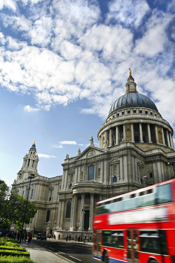 St Paul's Cathedral. Double decker passing by front of St Paul's Cathedral. Summer sky for copy space stock images