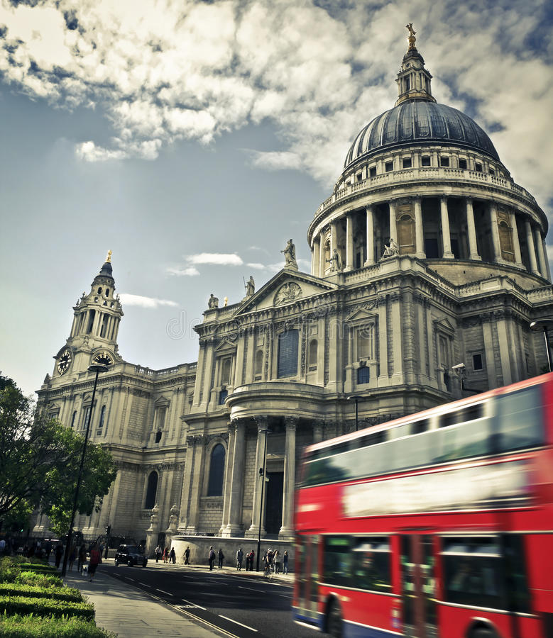 St Paul's Cathedral. Double decker passing by front of St Paul's Cathedral. Summer sky for copy space royalty free stock photo