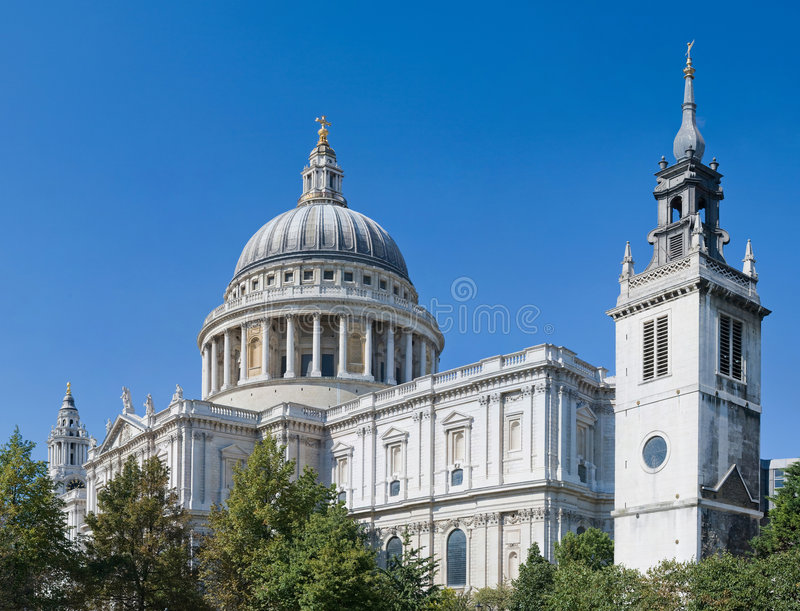 St Paul's Cathedral above the trees. St Paul's Cathedral on a magnificent clear summer day in London royalty free stock image