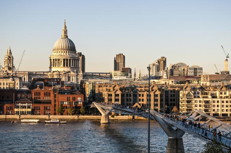 St Paul`s Cathedral and Millennium bridge, London, UK. Cityscape with St Paul`s Cathedral and Millennium bridge, London, UK stock image