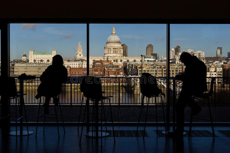 St Paul`s Cathedral and the Millennium Bridge taken from inside the Tate Modern Museum in London, royalty free stock image
