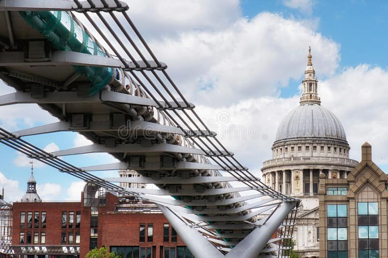 St Paul`s Cathedral and Millennium Footbridge over the Thames river, London, United Kingdom. royalty free stock photos