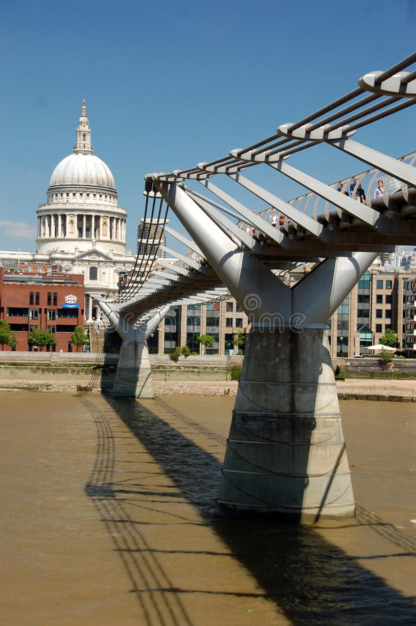 St pauls and the millenium bridge. Millenium bridge crossing the river thames providing direct access to saint pauls cathedral and the financial sector of london stock image