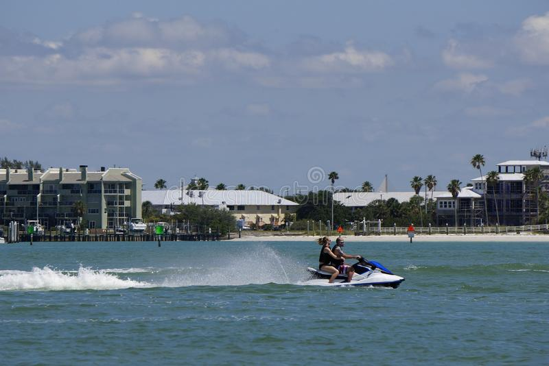 St. Pete Beach, Florida, April 2018: A couple on a Jet Ski on the Gulf of Mexico. People enjoying a sunny spring day while riding a Jet Ski on the Gulf of royalty free stock image