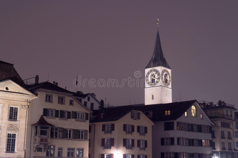 The St. Peter church with houses roofs from Zurich stock photo