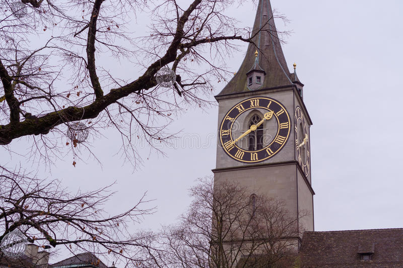 The St. Peter church tower with the big clock from Zurich stock images