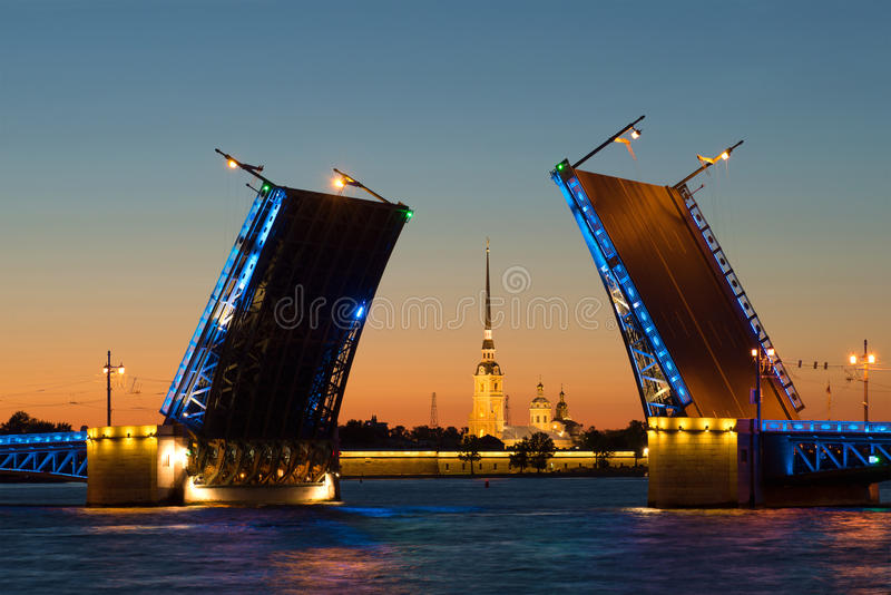 St. Peter and Paul Cathedral in the alignment of the drawn Palace bridge, night. Saint Petersburg royalty free stock photo