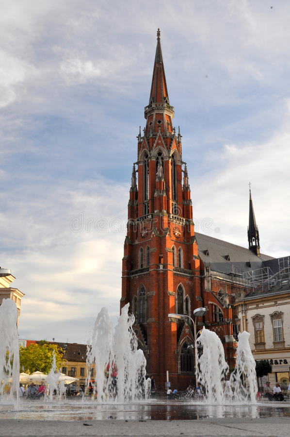St. Peter and Paul Cathedral in Osijek, Croatia. A fountain on main city square (Trg Ante Starcevica) with Saint Peter and Paul Cathedral in Osijek, Croatia stock image