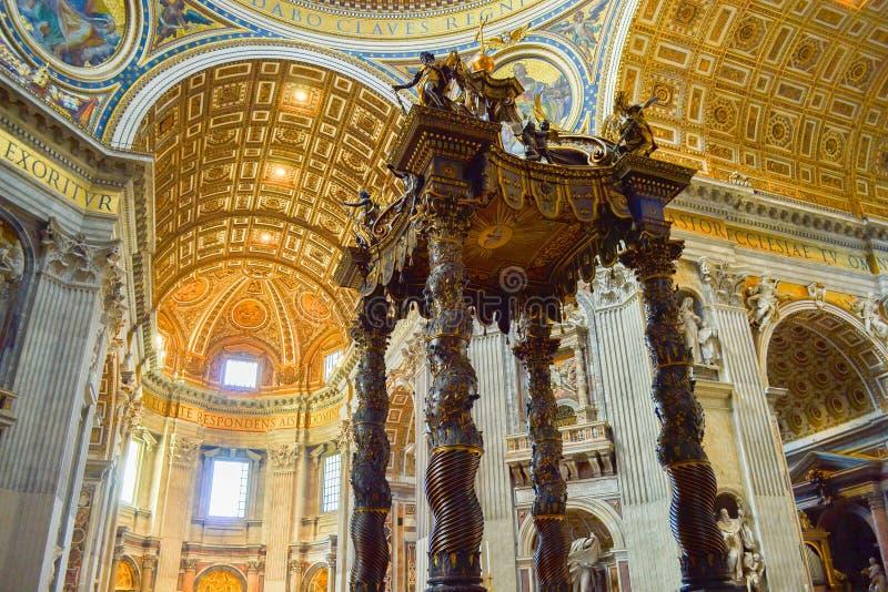 St. Peter`s Baldachin Baldacchino di San Pietro, L`Altare di Be. Rnini inside of St. Peter`s Basilica, in Vatican City, Italy royalty free stock photo