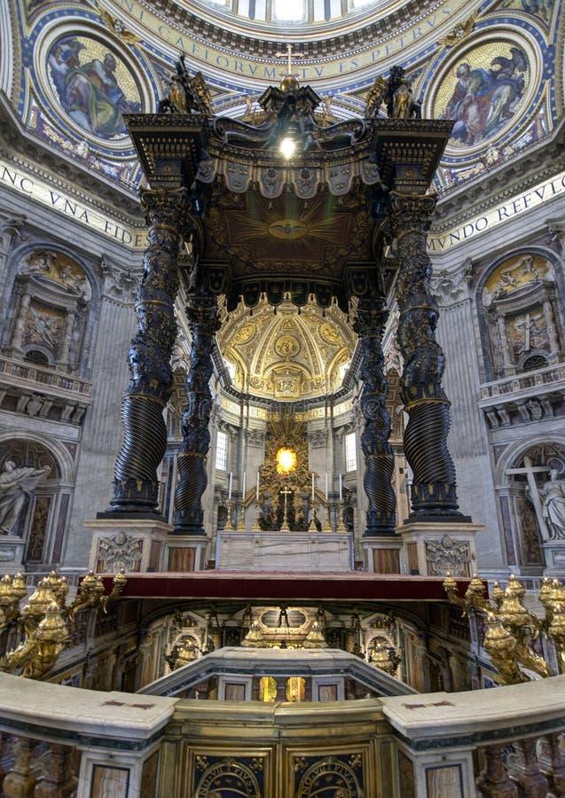 St. Peter's Baldachin, Vatican, Rome. St. Peter's Baldachin (Italian: Baldacchino di San Pietro) is a large Baroque sculpted bronze canopy, designed by Bernini royalty free stock image