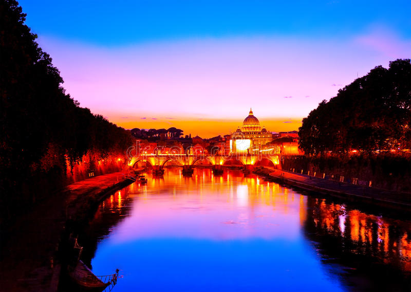 St. Peter`s Basilica at dusk in Rome. View of St. Peter`s Basilica and Aelian Bridge at dusk in Rome stock photo
