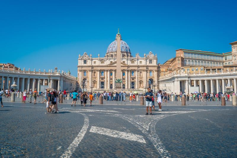 St. Peter`s Square in Vatican City. St. Peter`s Basilica and the Egyptian Obelisk in St. Peter`s Square in Vatican City royalty free stock image