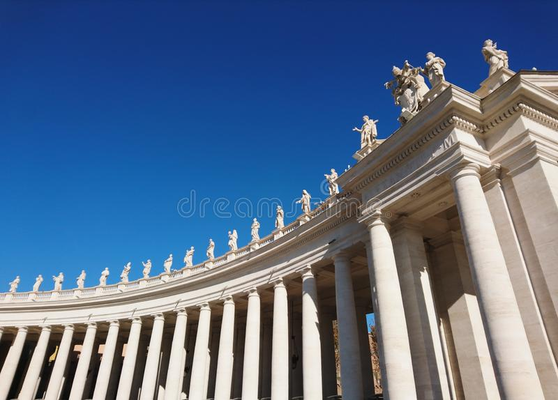 St. Peter`s Basilica in Roma with columns and fountains stock images