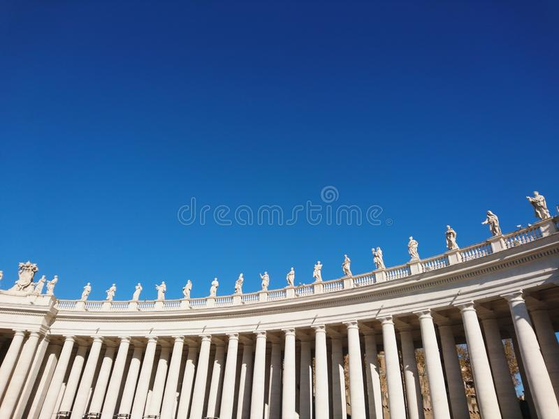 St. Peter`s Basilica in Roma with columns and fountains stock photo