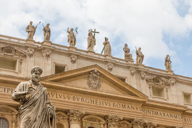 St. Peter`s Basilica with the statue of Saint Peter. Vatican City. St. Peter`s Basilica in Vatican City with the statue of Saint Peter in the foreground stock photo