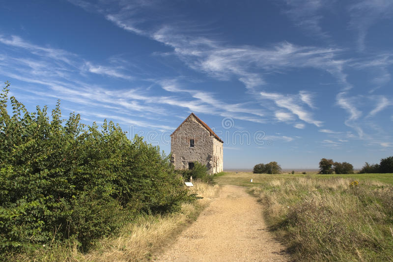 St Peter's Chapel, Bradwell-on-Sea, Essex, England. Road leading to St Peter's-on-the-Wall Chapel, Bradwell-on-Sea, Essex, England royalty free stock photography