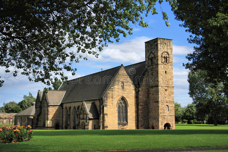St Peter's Church & Roses. St Peter's Church at Monkwearmouth, Sunderland, Northeast England. One half of the twin Anglo-Saxon monastery of Wearmouth royalty free stock images