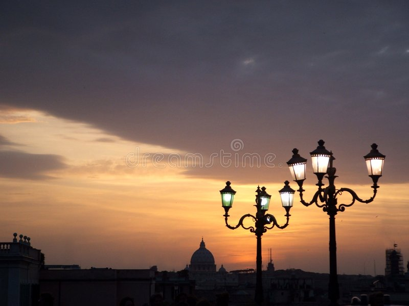 St peter's dome at sunset with street lamps royalty free stock photography