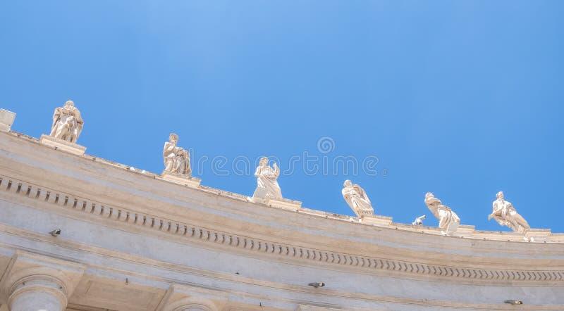 St. Peter`s Square colonnades` sculptures. Sculptures on the top of St. Peter`s Square colonnades royalty free stock photos