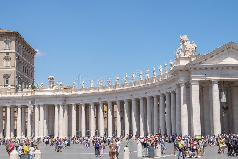 St. Peter`s Square colonnades. VATICAN CITY, VATICAN - JULY 14: St. Peter`s Square colonnades on July 14,2019. St. Peter`s Square is a plaza located in front of royalty free stock images