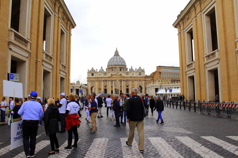 St Peter`s square entrance Vatican Rome. Italian people protesting at Via della Conciliazione St Peter`s Basilica at the distance, Vatican City, the papal stock photos