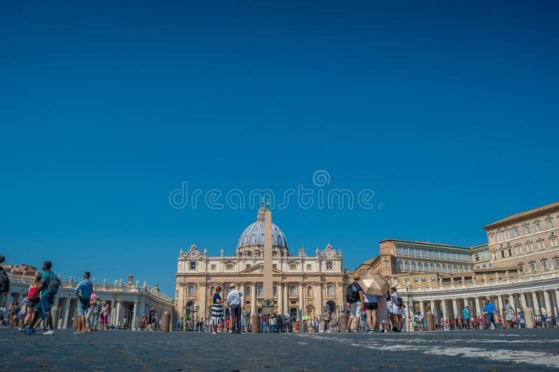 St. Peter`s Square in Vatican City. St. Peter`s Basilica and the Egyptian Obelisk in St. Peter`s Square in Vatican City stock photos