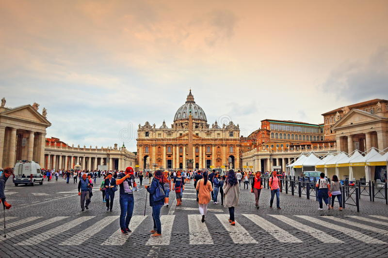 St Peter`s square Vatican Rome Italy. Tourists sightseeing on St. Peter`s square or Piazza San Pietro Vatican ,UNESCO World Heritage Site stock images