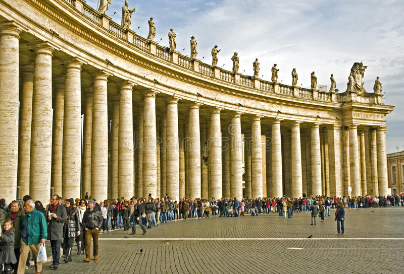 St Peter Square. Rome, Italy - January 8, 2011: Visitors are waiting in line along the Colonnade of the St Peter Square to enter into the St. Peter Cathedral stock photography