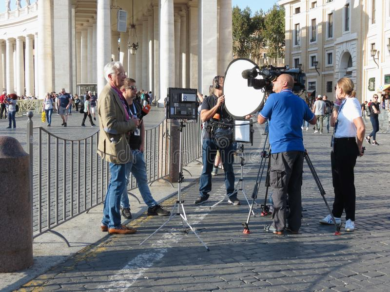 St Peter Square Piazza San Pietro in Vatican City. VATICAN CITY, ROME, VATICAN CITY STATE - CIRCA OCTOBER 2018: 2DF German tv troupe in St Peter`s Square Piazza stock photography