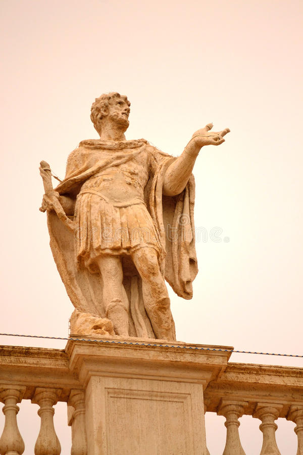 St. Peter square saint statue Vatican. Statue of St Marinus on the top of North Colonnade of St Peter`s square,Vatican city Rome,Italy.It is part of the group of stock photo