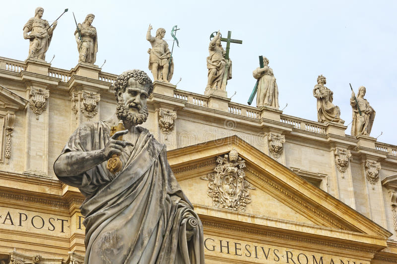 St. peter statue and basilica, Rome. Statue of St. Peter in front of the Basilica. The statue of Jesus Christ is visible in the center stock photo