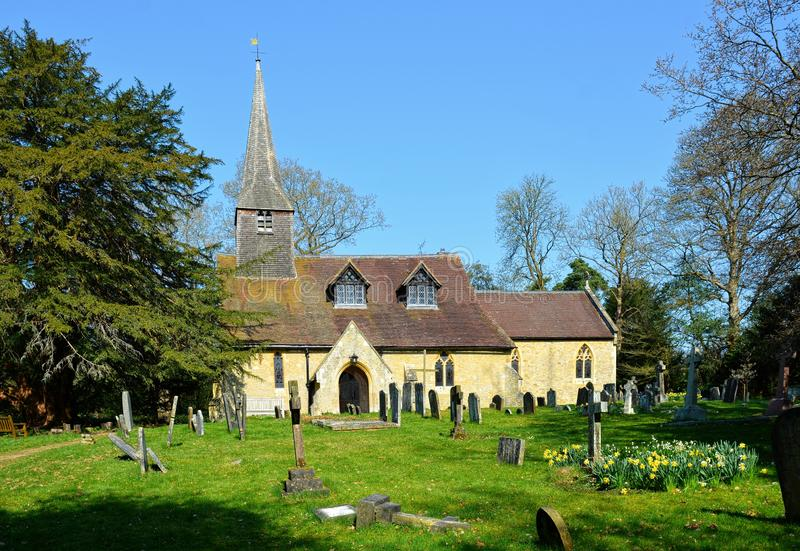 St Peters Church and Yew Tree, Tandridge, Surrey, UK. St Peter's is an Anglican parish church serving the village and parish of Tandridge, in East Surrey royalty free stock photos
