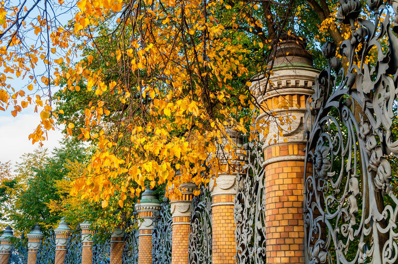 St Petersburg autumn view- fence of the Mikhailovsky Garden in St Petersburg, Russia in autumn sunny day royalty free stock photo