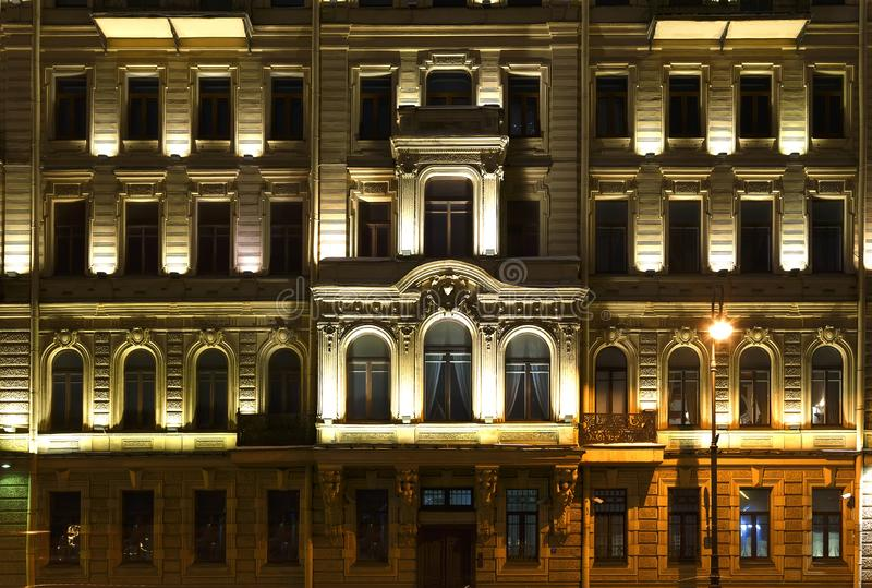 St. Petersburg facade of the historical building in Baroque style, night illumination, Neva embankment. Several windows in a row on night illuminated facade of royalty free stock photography