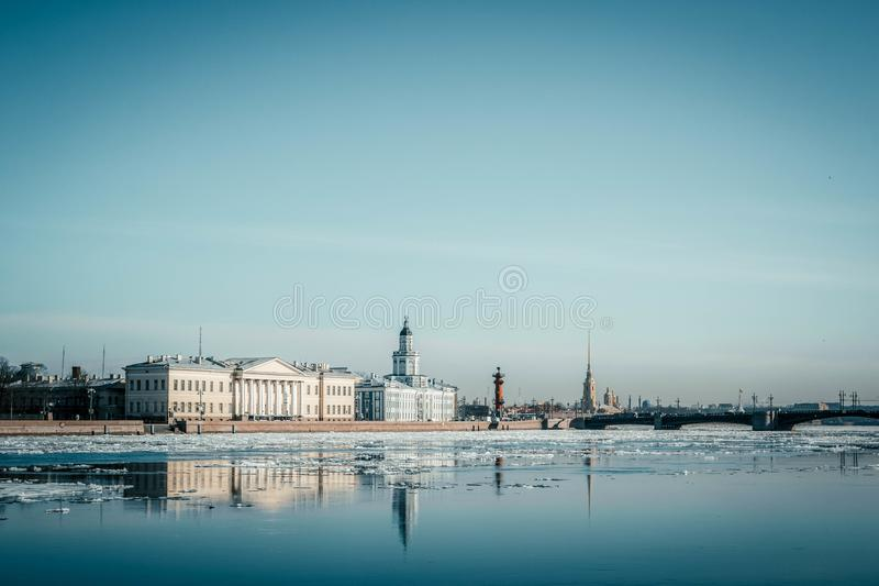 St. Petersburg granite embankment, panoramic view from Neva River on cityscape and architecture of city, spring ice drift, Saint stock photography