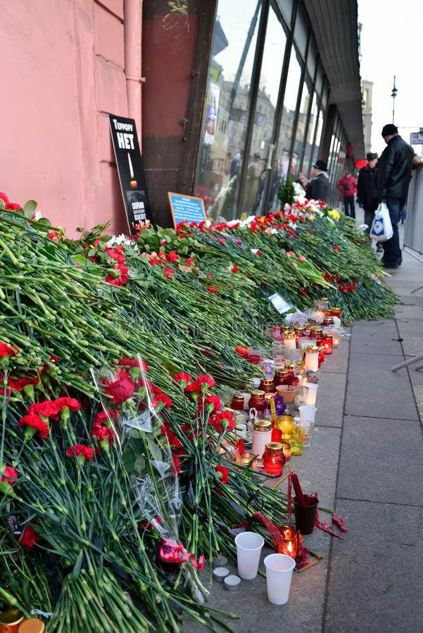 Funeral flowers at the poster TERROR is NOT near the metro Institute of Technology after an explosion on 3 April 2016 stock images